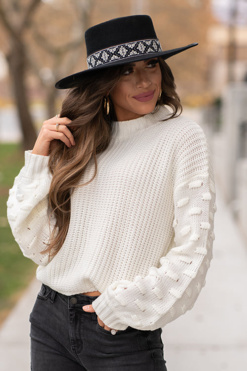 "Miss Sparkling  Sweater up girl, its getting cold outside. This belle sleeve sweater is too cute paired with ankle booties and skinny jeans for dressing up this winter.  Collection: Winter 2020 Color: Creamy White Neckline: Round Neck Sleeve: Long Sleeve 100%Acrylic Style #: D205024-White Contact us for any additional measurements or sizing.  Taylor is 5'7"" and wears a size 4 in jeans, small top and an 8.5 in shoes. She is wearing a size small in this sweater."
