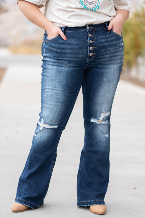 "KanCan Jeans  Collection: Fall 2020 Skinny, 34"" Inseam  High Rise, 11.5"" Front Rise Dark Blue Wash  COTTON 94% POLYESTER 5% SPANDEX 1% Fly: Exposed Button Fly Style #: KC6327D-PL Contact us for any additional measurements or sizing.  Victoria's wears a 16W and is wearing a size 2XL in these jeans."