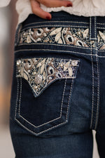 "Miss Me Collection: Fall 2020 Wash: Dark Wash Material: 91% Cotton, 6% Polyester, 3% Elastane Sequin Trim and Rhinestone Rivets  Mid Rise, 8.75"" Front Rise Embellished Floral Filled Pockets  Style #: M3655S Get lost in this gorgeous pair of skinnies detailed with hand sanding, contrast stitching and embroidered floral inserts.  Contact us for any additional measurements or sizing."