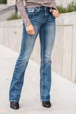 "Miss Me Collection: Fall 2020 Wash: Dark Wash Inseam: 34"" Inseam Material:  Sequin Trim and Rhinestone Rivets  Mid Rise, 8.75"" Front Rise Embellished Horseshoe Pocket  Style #: M3694B Contact us for any additional measurements or sizing.  Taylor is 5'7"" and wears a size 4 in jeans, small top and an 8.5 in shoes. She is wearing a size 26 in these jeans."