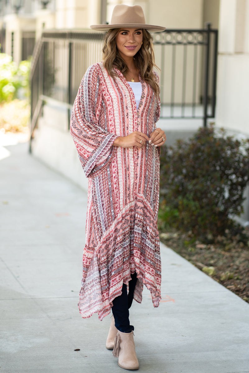 Miss Me  Collection: Summer 2020 Maxi Printed Kimono Color: Cherry Red Button Fown Material: 100% Rayon Style #: MJ0146S Show off your inner wild child with this dreamy kimono featuring an all over print, open front, long sleeves and a maxi cut.