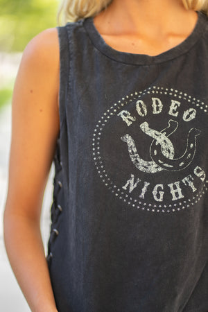 Miss Me  Collection: Fall 2020 Rodeo Nights Tanks Color: Black Cut: Sleeveless Top 100% Cotton Style #: MJT0062T Enjoy rodeo nights in this adorable sleeveless top featuring a printed horseshoe with writing that says rodeo nights, tie up detailing at sides, and a round neck line.