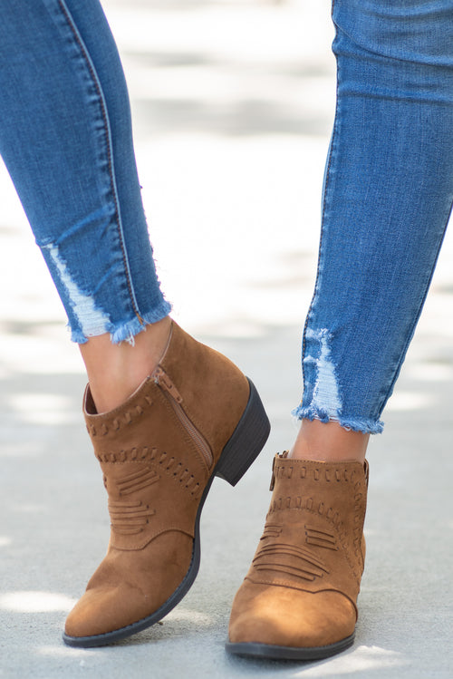 Ankle Booties by Qupid Style Name: Rowdy Cowgirl Color: Maple Brown Cut: Ankle Boots Zip Boot with Western Front Material. Outsole: Rubber Upper: Textile/Manmade  Contact us for any additional measurements or sizing.