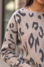 "Hem & Thread   Extenuate your waist with this leopard print dolman sweater.   Collection: Fall 2020 Color: Leopard Print Neckline: Boatneck  Sleeve: Long Sleeve SELF: 74% ACRYLIC 22% POLYESTER 4% SPANDEX  Style #: 8412F Contact us for any additional measurements or sizing.  Layla is 5'9"" and wears a size 2 in jeans, small top and an 8 in shoes. She is wearing a size small in this sweater."