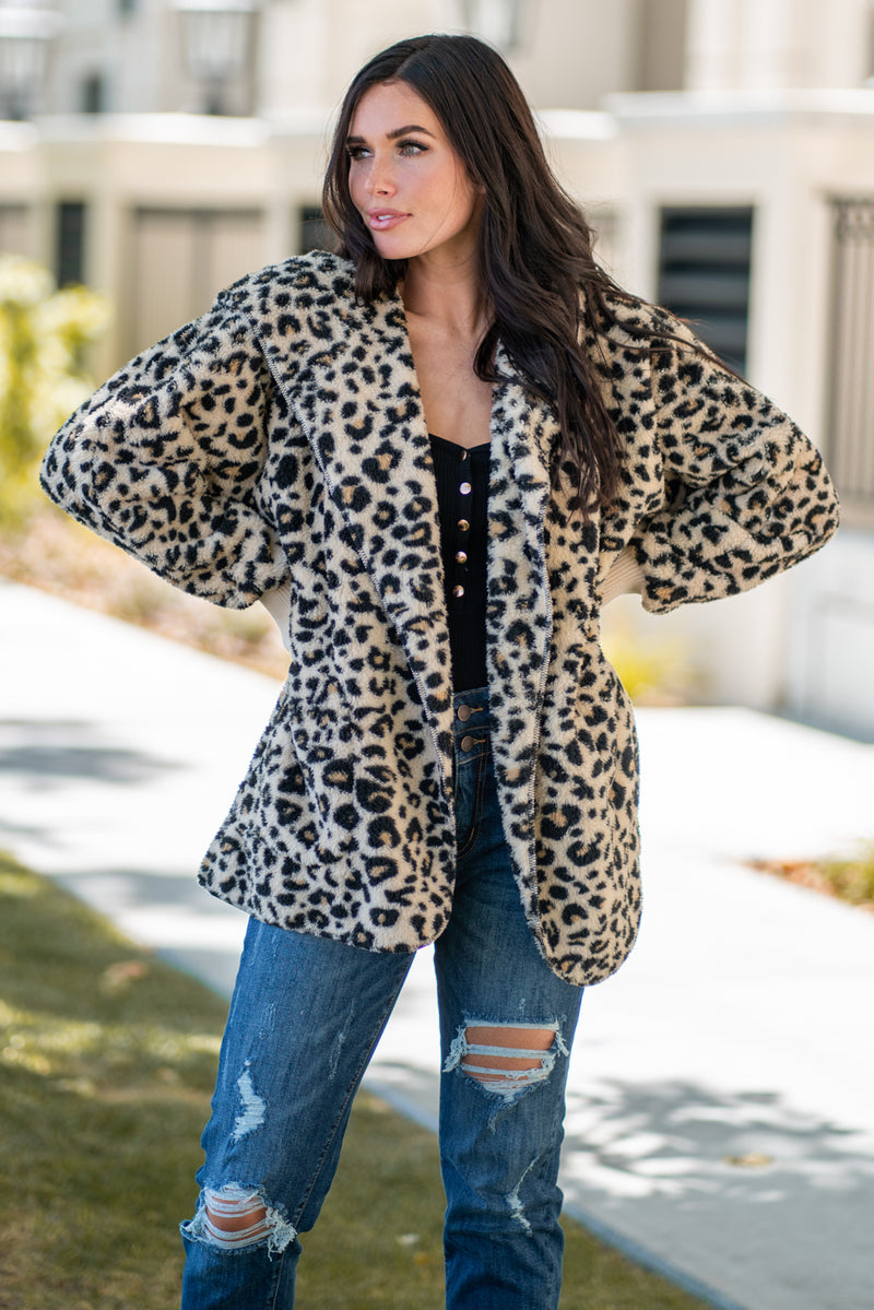 Hem & Thread   Feel your inner animal in this leopard print sherpa jacket. Pair with a great boyfriend denim in heels for a trendy fun look.  Collection: Fall 2020 Color: Leopard Neckline: Open Sleeve: Long 100% POLYESTER 97% ACRYLIC 3% SPANDEX Style #: 8432 Contact us for any additional measurements or sizing.  Haley is 5'6