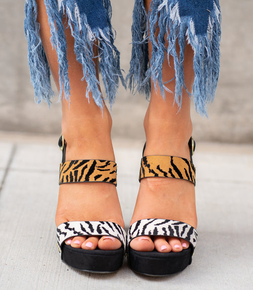 Tiger Print Block Heels by Qupid Style Name: Lighting-15x Color: Stone Black Tiger Faux Suede  Cut: Strap Heels Material. Outsole: Rubber Upper: Textile/Manmade  Contact us for any additional measurements or sizing.