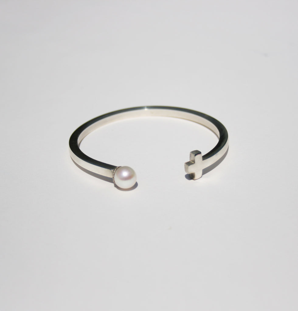 Cross and pearl bangle