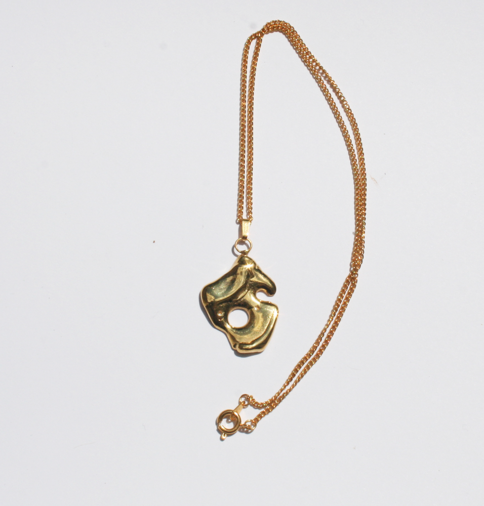 Moon Diver gold pendant necklace