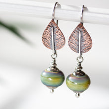 Load image into Gallery viewer, Pastel Green Earrings, hammered copper leaf with lampwork beads