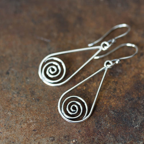 Long silver teardrop earrings with spirals inside - jewelry by CookOnStrike