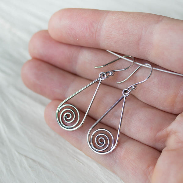 Long silver teardrop earrings with spirals inside