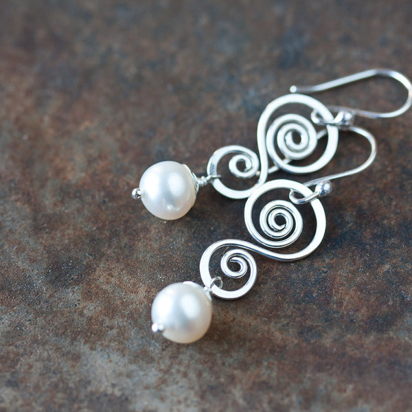 Elegant sterling silver earrings, natural white freshwater pearl drop on hammered double spiral