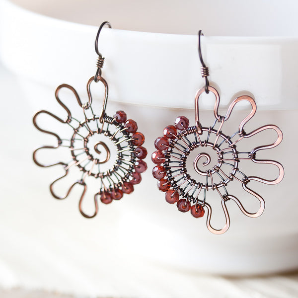 Unusual Garnet Edge Earrings, wire wrapped asymmetric copper spiral - CookOnStrike