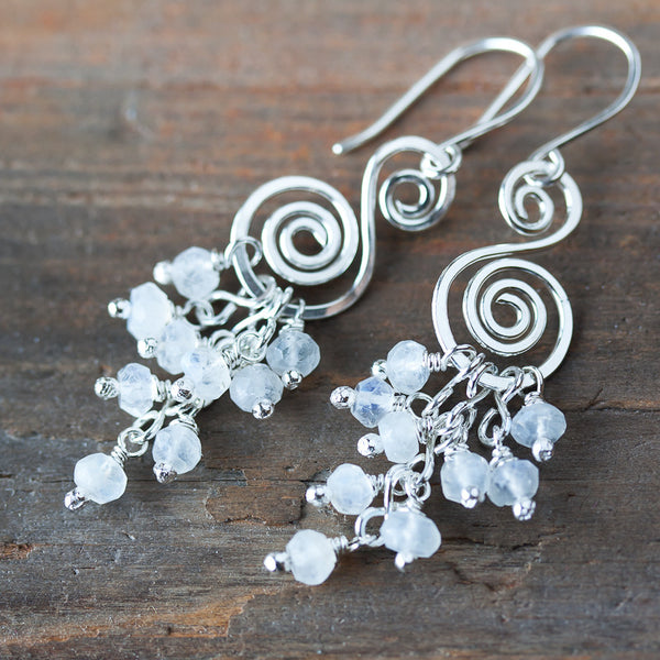 Natural Rainbow Moonstone Earrings, cascading white gemstones on a forged silver spiral