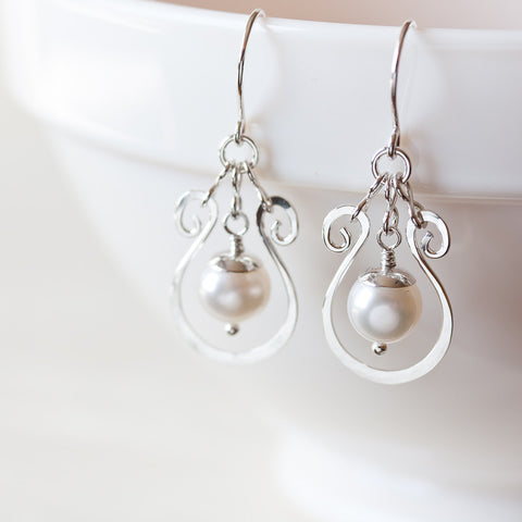 Elegant white pearl earrings, hammered silver drop frame