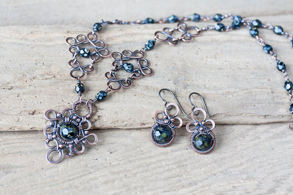 Small Earthy Green Dangle Earrings, marbled Picasso glass beads, wire wrapped oxidized copper - CookOnStrike