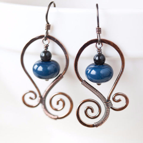 Dark denim blue earrings, oxidized hand forged copper spirals