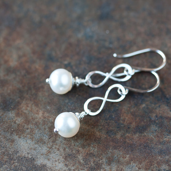Sterling silver infinity earrings, natural lustrous white freshwater pearl drop