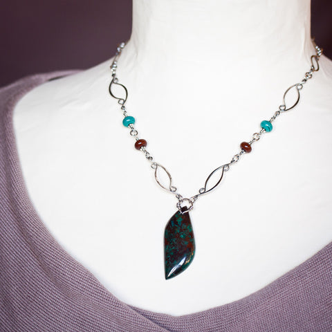 Sterling silver necklace with asymmetric malachite in cuprite stone leaf pendant