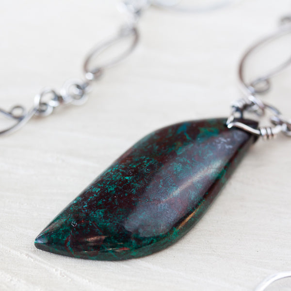 Handcrafted sterling silver necklace with asymmetric green brown malachite in cuprite stone pendant