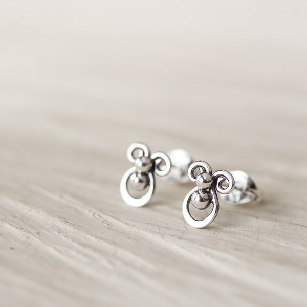 Tiny unusual artisan stud earrings, abstract silver shapes