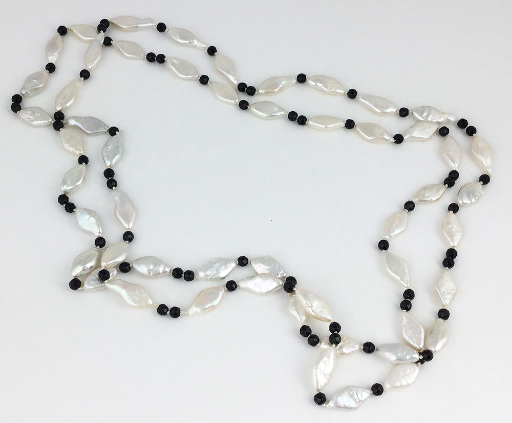 46 inches of Diamond shaped white pearls with black onyx faceted rondelles necklace that can be worn long or doubled