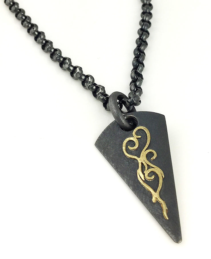 Arrowhead pendant in oxidized silver and 18k yellow gold by Alishan.