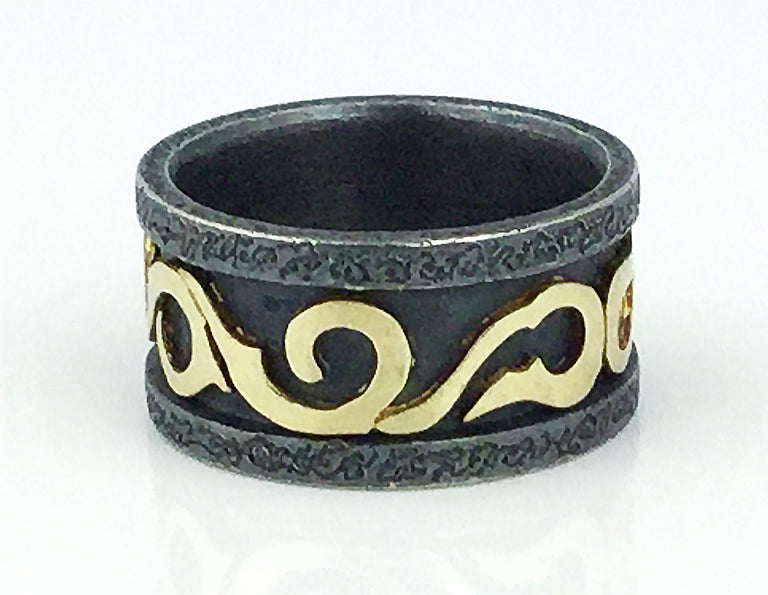 Ring by Alishan in oxidized silver featuring 18k yellow gold scroll work.
