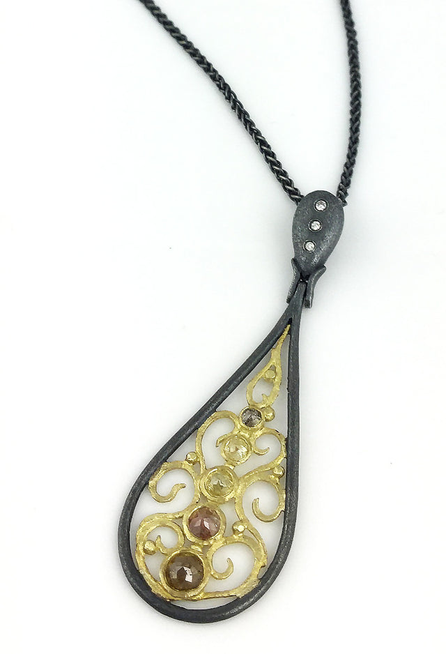 Rose cut natural colored diamonds stand out in this Alishan pendant with oxidized silver and 18k yellow gold.