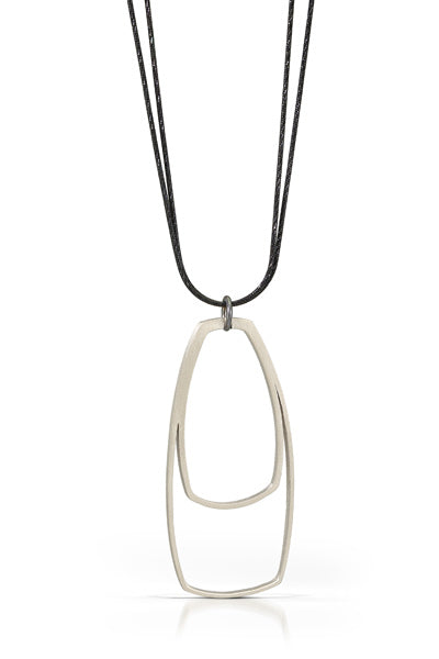 "The large spotlight pendant by Bree Richey comes on a 36"" oxidized diamond cut chain.  Great on a sweater or layered with shorter necklaces"