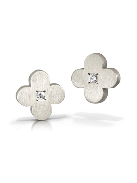 Circle flower studs in matte silver finish with diamonds by Bree Richey.