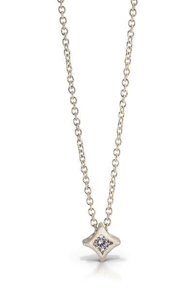 Star pendant in sterling silver with a .04ct white diamond on a 18 inch sterling silver chain.