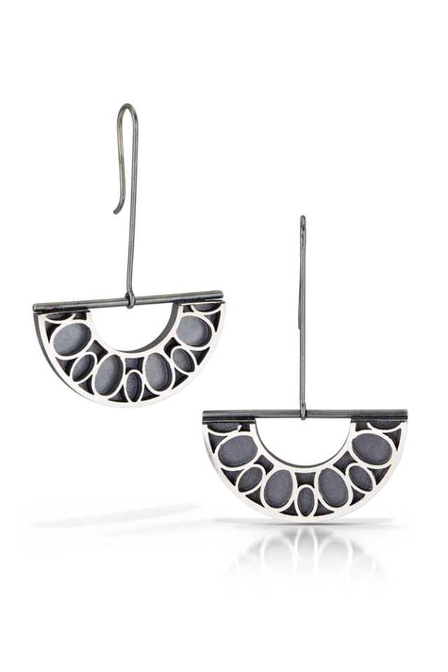Half-burst silver earrings in shadow finish on drop wires by Bree Richey.