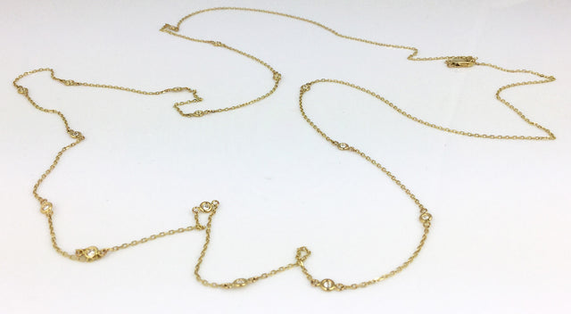 Great on its own or as a layering piece, this simple yet elegant necklace is in 14k yellow gold and features 0.5ctw bezel set white diamonds.  The total length is 36""