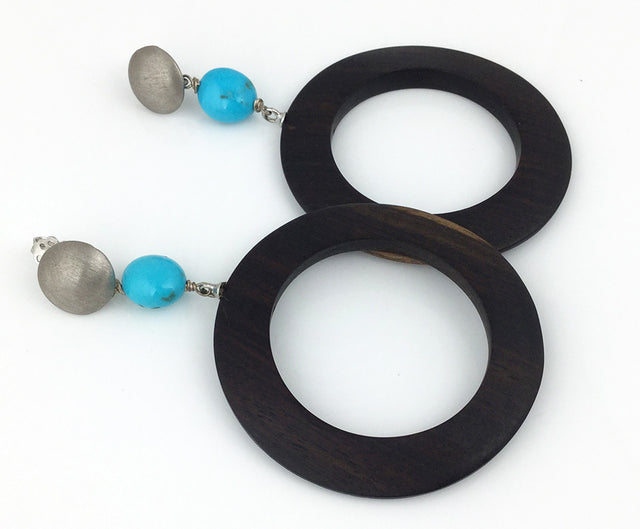 Surprisingly lightweight and easy to wear, this large ebony circle earrings with turquoise and sterling silver are a fun addition to your jewelry collection!