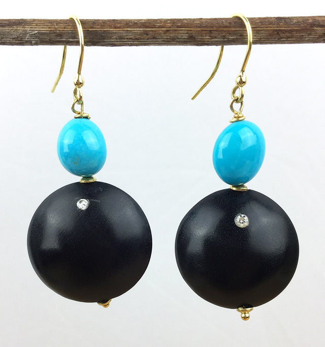 Sleeping beauty turquoise takes center stage in these 18k yellow gold earrings with ebony and diamonds.