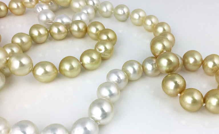 38 inch white and gold south sea pearl necklace with 18k yellow gold clasp