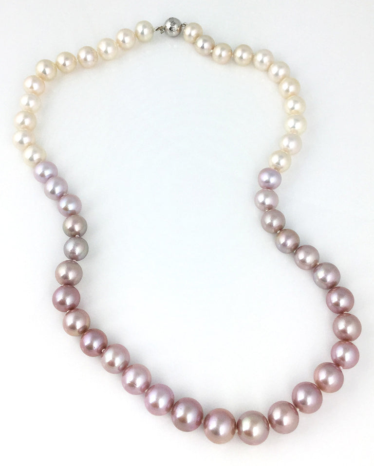 Pink to white ombre strand of very fine freshwater pearls with 18kwg clasp