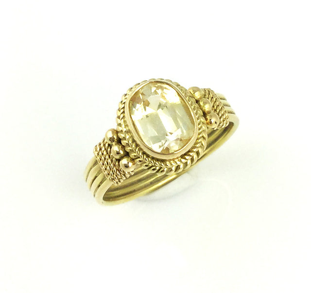 Handmade 18k yellow gold ring with 2.15ct fancy yellow sapphire.  Size 7.5.