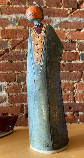 "Local Maysville artist Fred Wiesener has been creating his classic ladies for decades.  This example stands 16"" tall and has an understated green glaze."