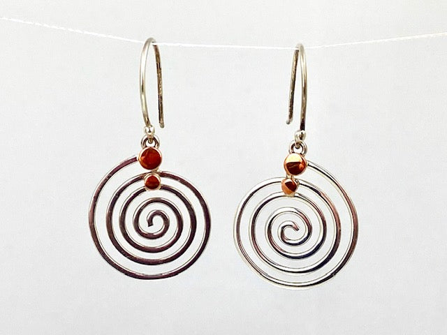Sterling silver and copper dangle earrings by designer Guillermo Arregui.