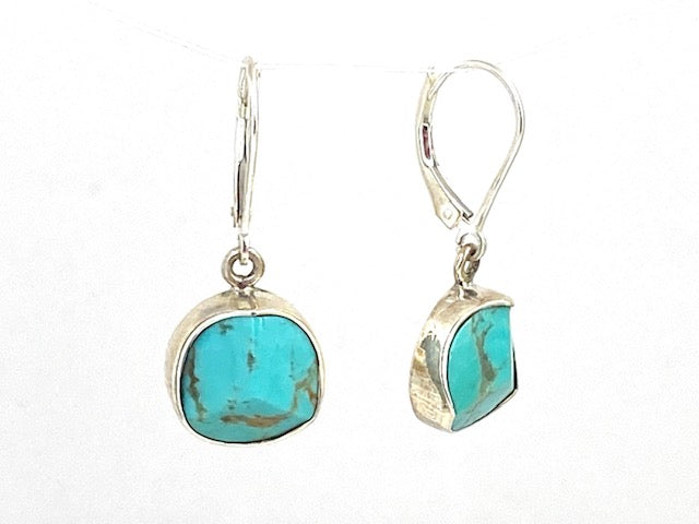 Sterling Silver Faceted Turquoise bezel lever back earrings by designer Guillermo Arregui.