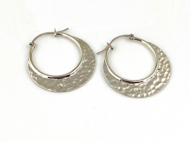 Sterling Silver Hammered hoop earrings by designer Guillermo Arregui.