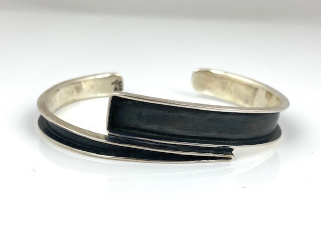 Silver/Oxidized Silver Double Point Cuff by designer Guillermo Arregui.    6 1/2""