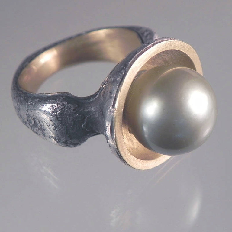 Natural Tahitian pearl ring by Michael Jensen Designs in sterling silver with 22k yellow gold.