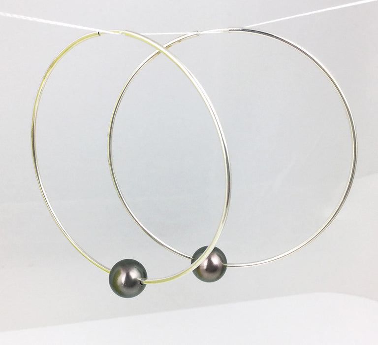 Fun & always in style these sterling silver hoops are 2 1/4 inches in diameter and feature two beautiful Tahitian pearls!