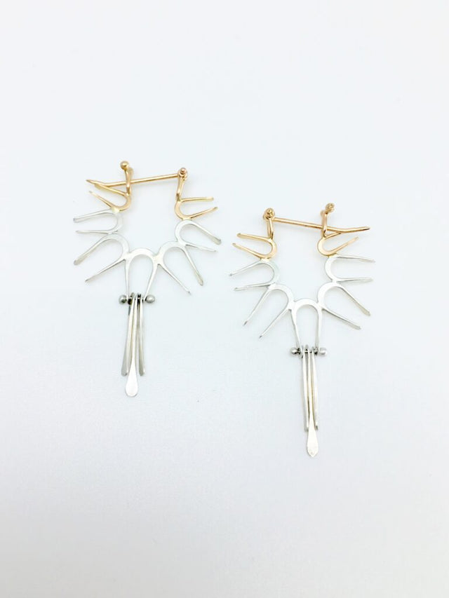 1 1/2″ in length and 1″ in width, although each pair is hand fabricated and therefore unique.  This pair is made of solid 14k rose gold and Argentium silver by Shayna Jingst