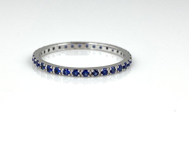 Blue sapphire eternity band (0.38ctw) in 18k white gold.