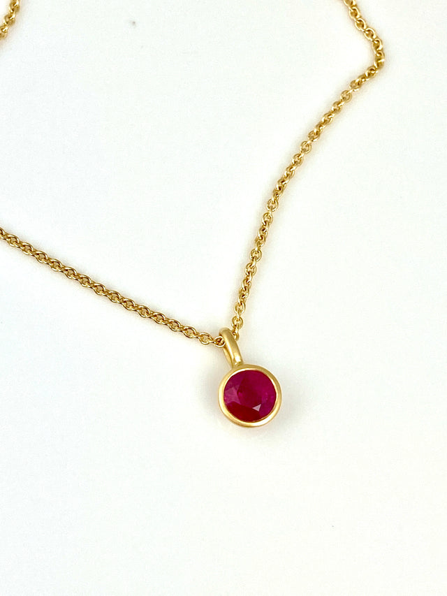18k yellow gold pendant with 0.70ctw ruby. Chain sold seperately.