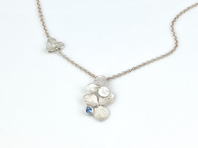 Sterling silver bright finish double 3-petal hydrangea necklace.  Accent 3-petal on the chain and an aquamarine on sterling silver chain.